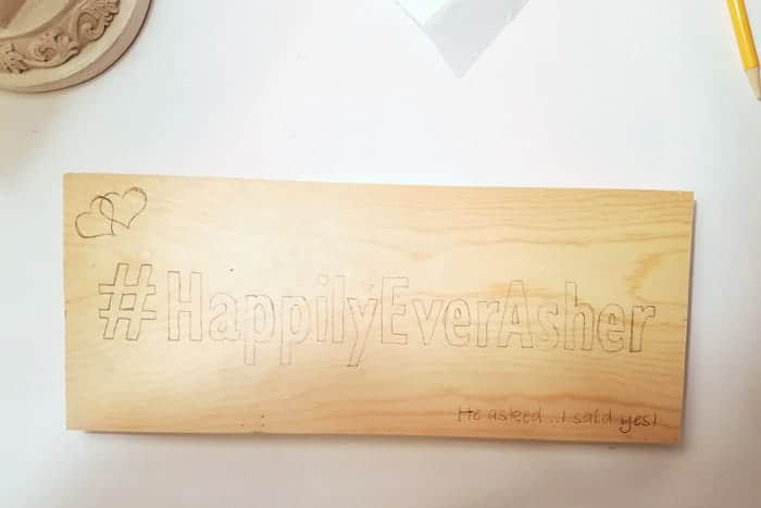 Beginner wood burning sign with traced pattern.
