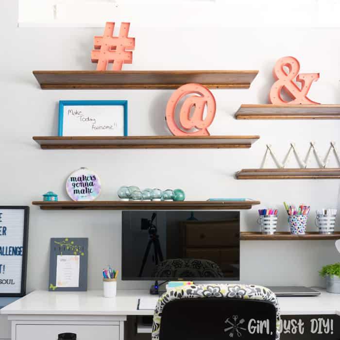 Square image of floating wood shelves.