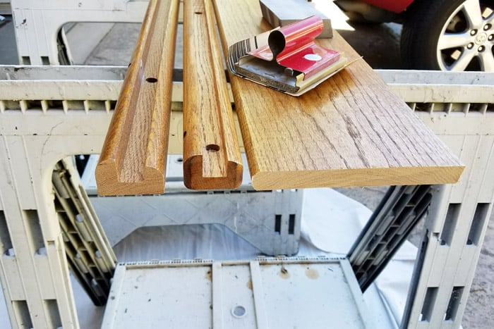 Sanding edges of floating wood shelves.