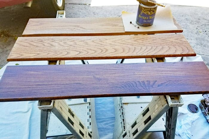 Staining floating wood shelves.