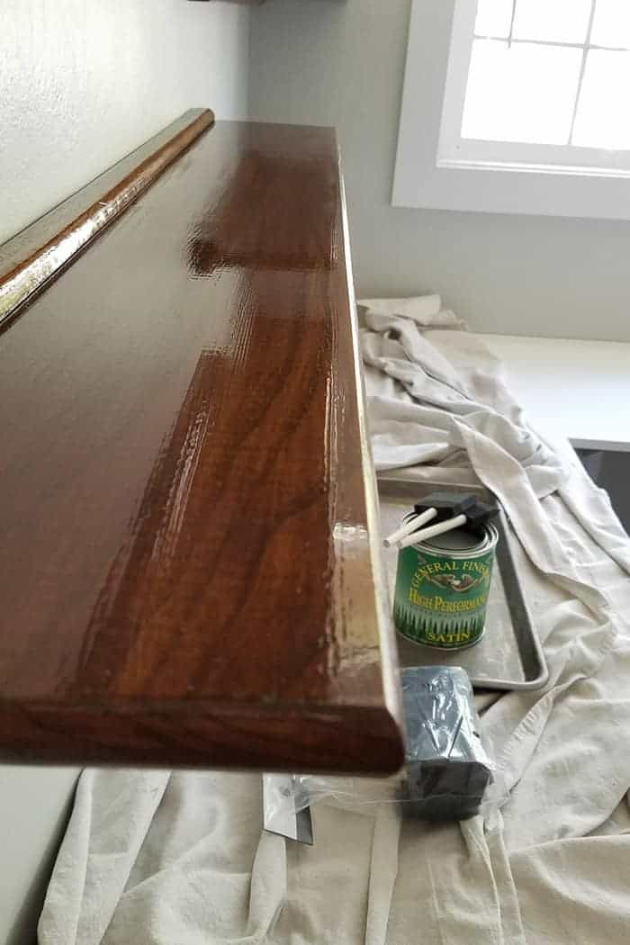 Final top coat on floating wood shelves is glossy.