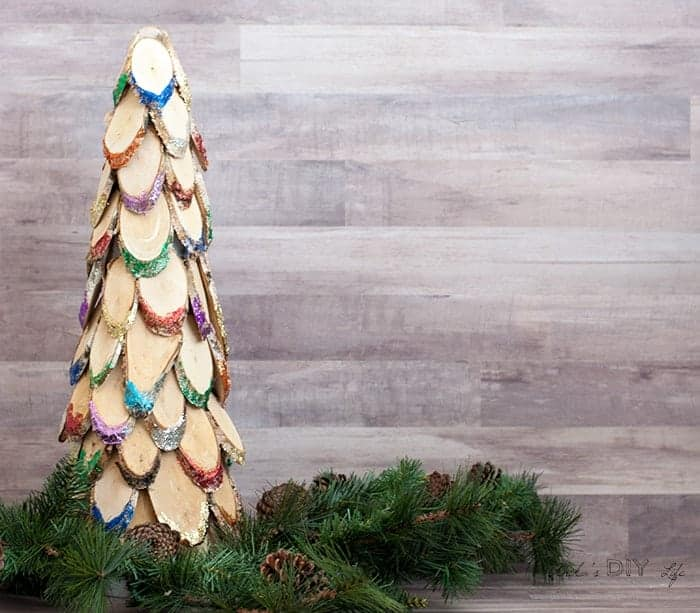 Wood slice Christmas tree with colorful glitter