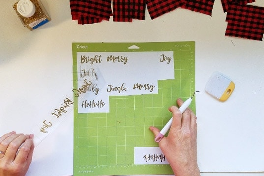 Cricut cut gold words for buffalo plaid ornament.s