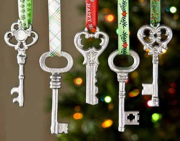 DIY Christmas Ornaments from old keys hung with pretty christmas ribbon.