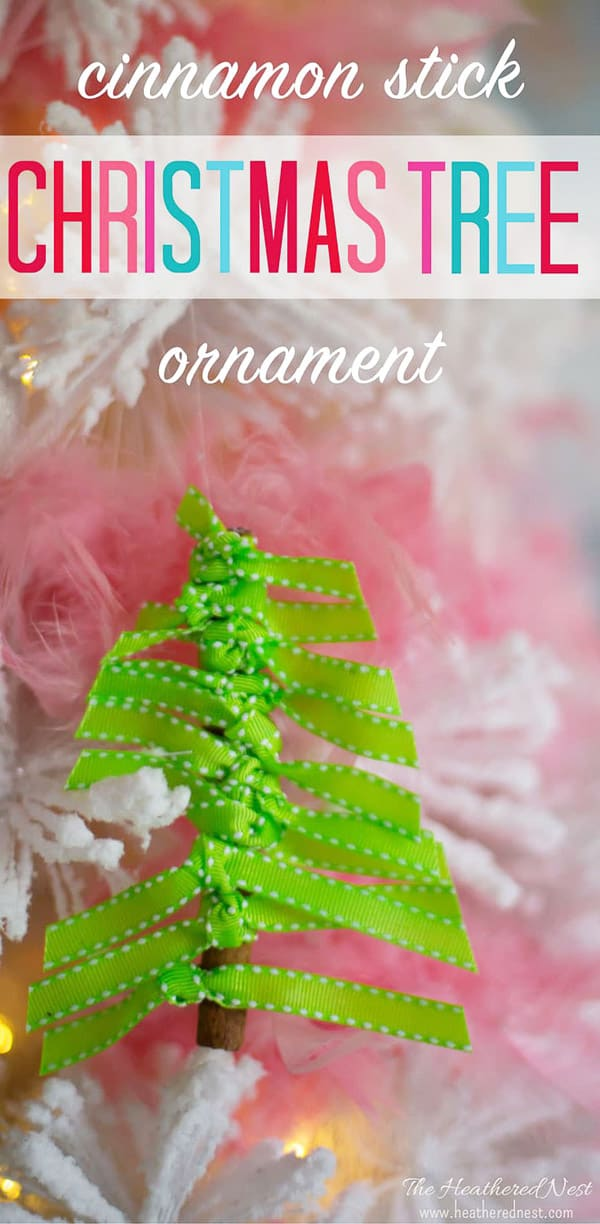 DIY Christmas Ornament green ribbon tied around cinnamon stick shaped like a tree.