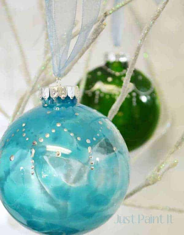 Painted glass bulb DIY Christmas Ornaments in blue and green.