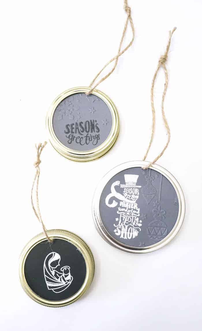 DIY Christmas Ornaments with embossed paper inside mason jar lids.