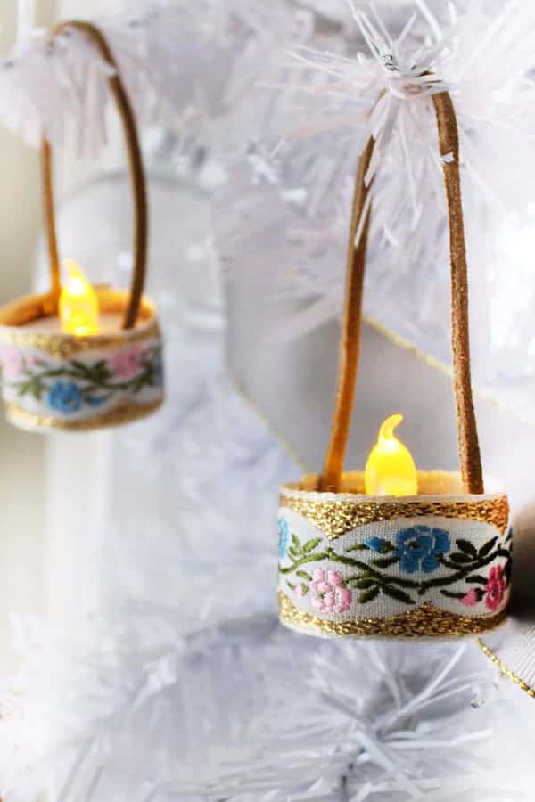 Mini Tealight DIY Christmas Ornaments wrapped with fabric ribbon.
