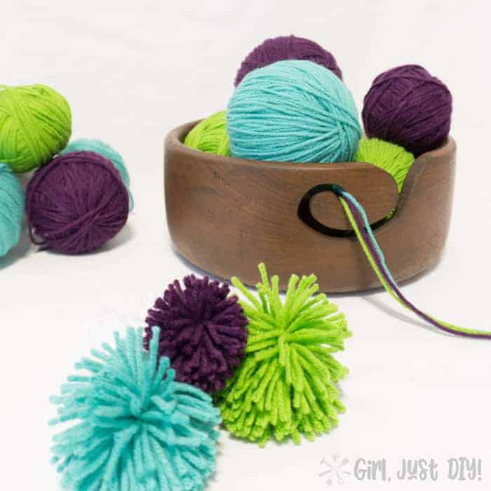 DIY yarn bowl filled with blue, purple, and green yarn.