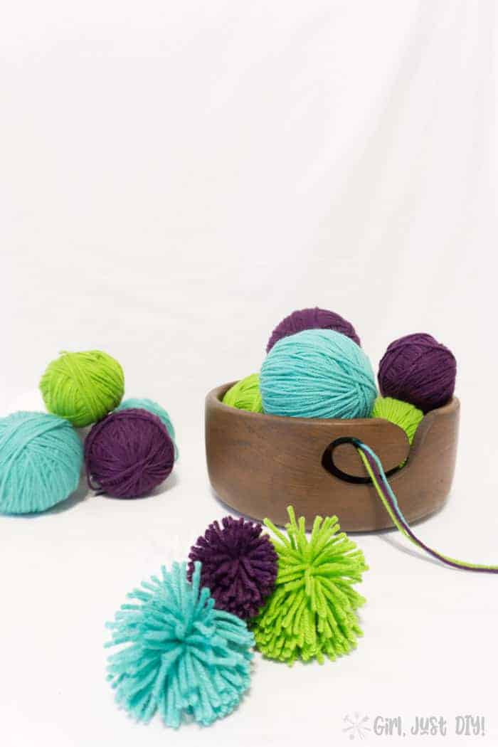 DIY Yarn Bowl stacked with colorful yarn balls.