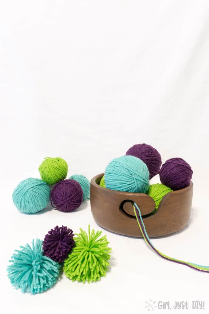 DIY Yarn Bowl stacked with yarn balls.
