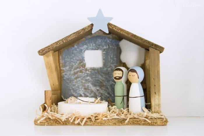 Peg doll nativity scene in creche