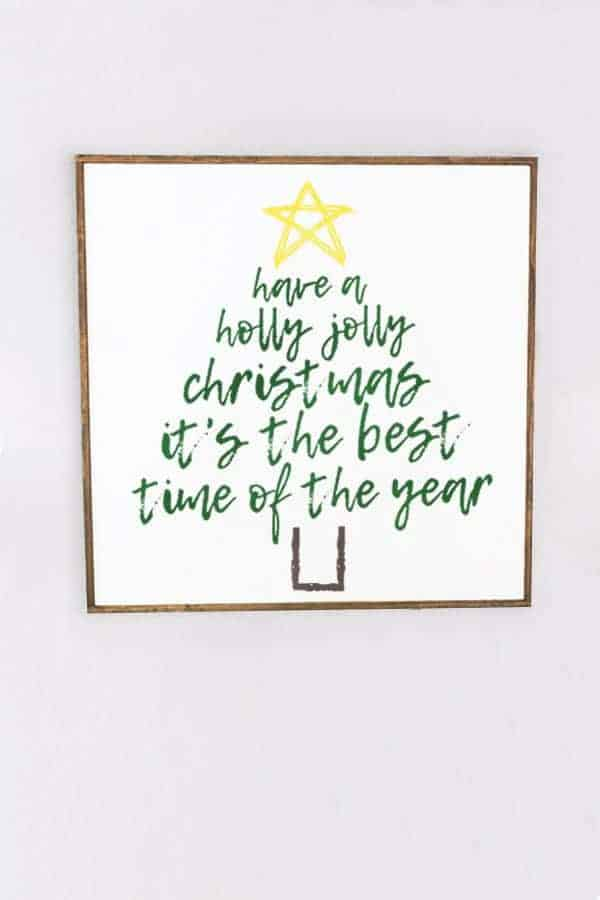 Holly Jolly song in shape of Christmas Tree wall hanging.