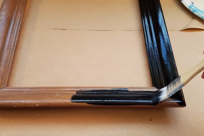 monogram door hanger frame gets painted black.