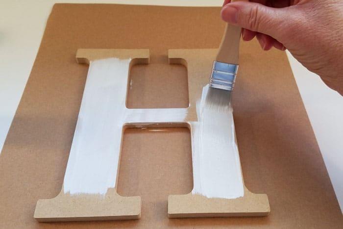 Initial letter is painted white for monogram door hanger.