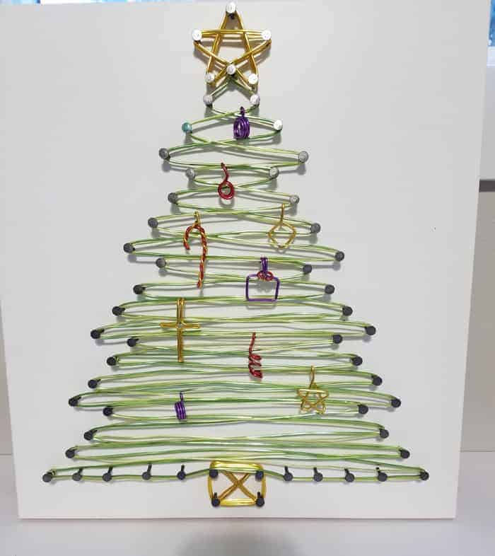 String Art Christmas tree with tiny ornaments.