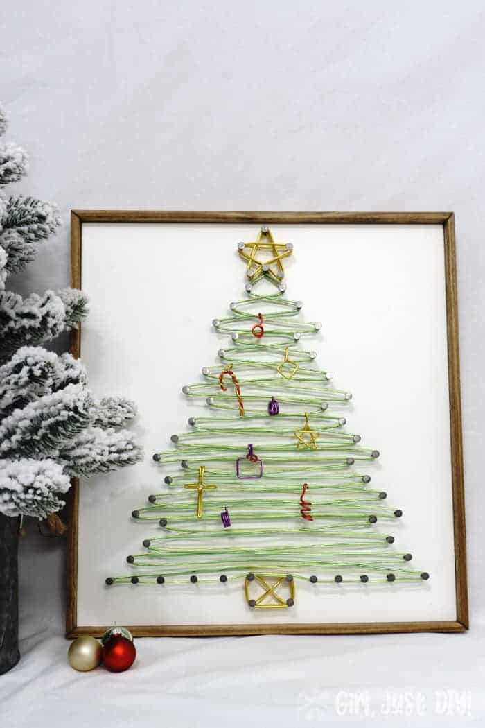 Completed string art christmas tree front view.