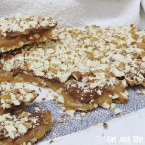 Homemade english toffee on blue kitchen towel.