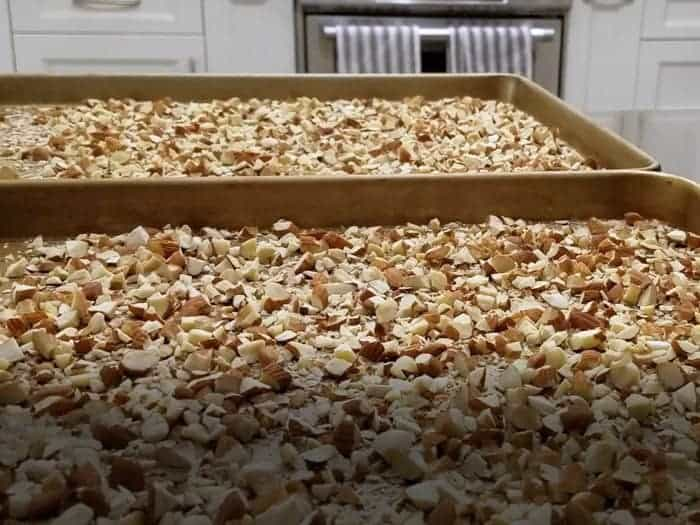 Chopped almonds spread on cookie sheet.
