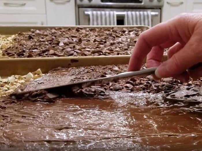 Spreading melted chocolate with knife.