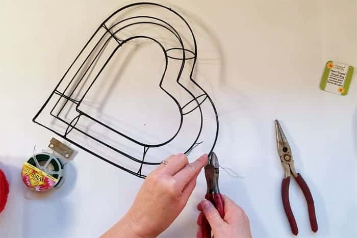Hear-shaped wire wreath forms getting wired together.