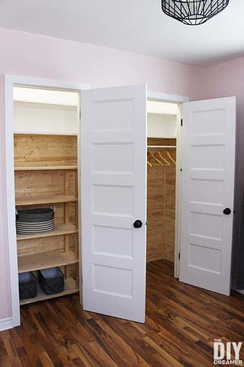 Side-by-side closets with built in closet shelves.