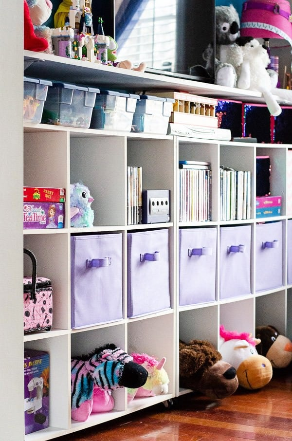 Cube storage in playroom filled with books and toys.