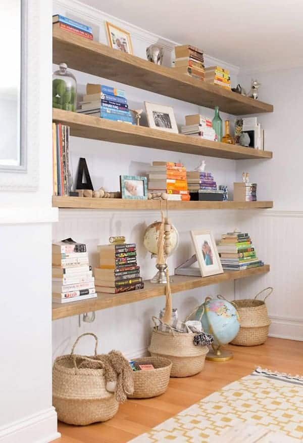 Floating shelves on long wall with books and decor.