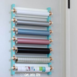 Craft vinyl strorage rack mounted on wall behind door.