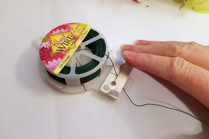 Cutting strips of floral wire for hydrangea wreath.