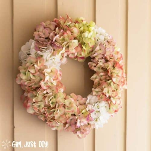 Faux hydrangea wreath hanging on porch wall