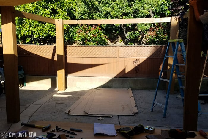 Partial diy patio gazebo frame assembled, 3 posts and fascia.