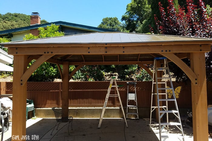 Fully installed diy patio gazebo with ladders underneath.