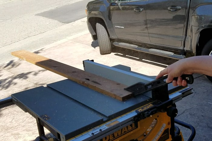 Ripping wood on a table saw.