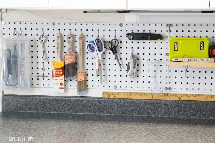 Tolls hanging on installed pegboard wall.