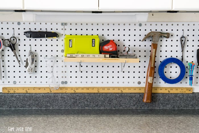 Installed Pegboard shelf with tools on top.