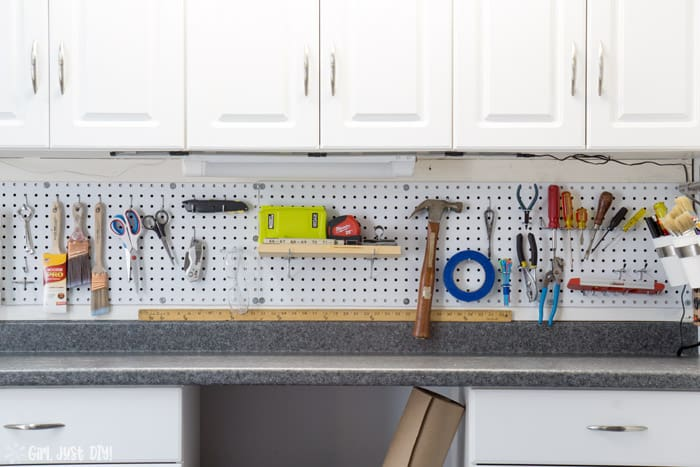 Wide shot of installed pegboard filled with tools.