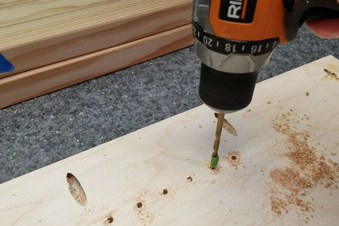 Drilling holes for shelf pins.
