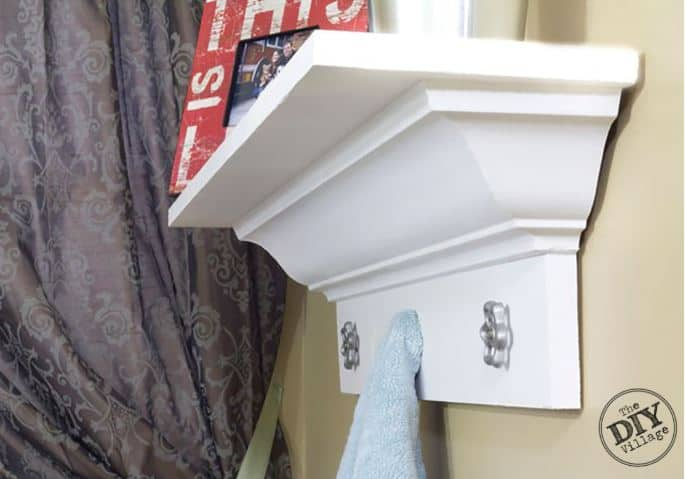 Shelf made from crown molding topped with picture frames.