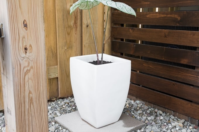 White flower pot on pedestal for outdoor diy projects.