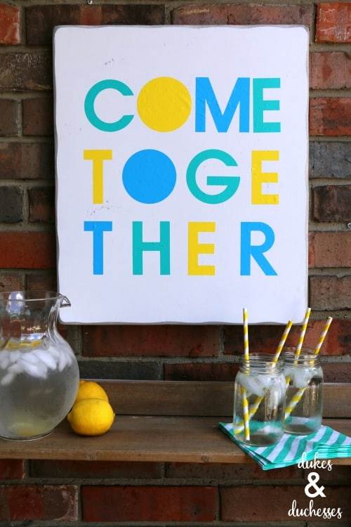 "Colorful ""Come Together"" sign for welcoming porch."