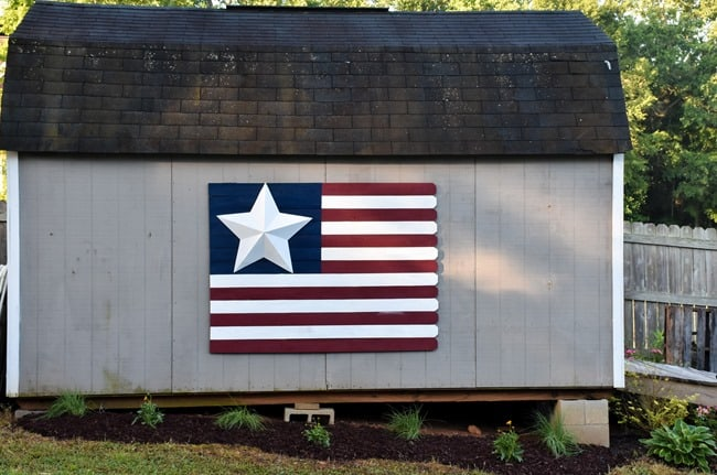 American Flag pickets on side of gray barn.