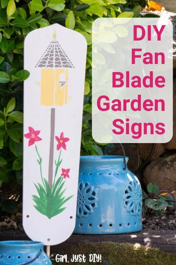 Birdhouse DIY Garden signs from fan blade in garden near blue lantern.