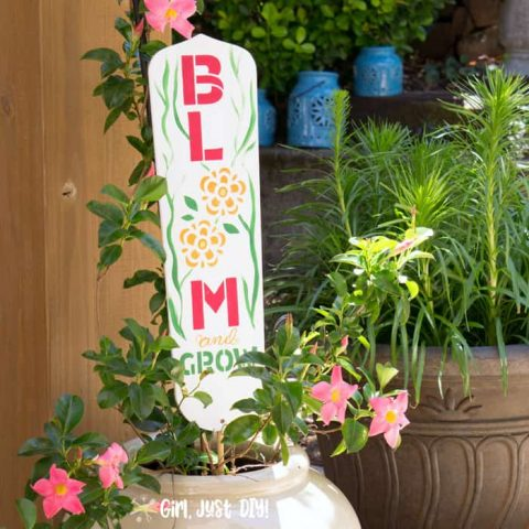 Bloom DIY Garden sign from fan blade in white pot with fining plant.