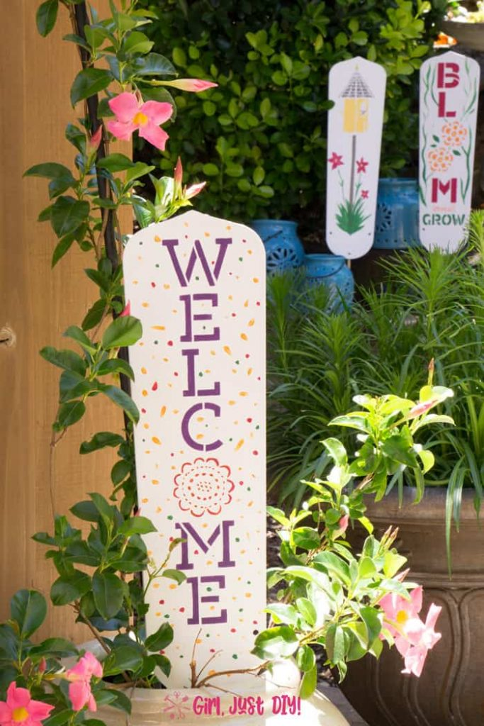 DIY Garden Signs in the garden. One in a pot and two in the flowers.n