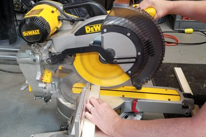 """1"""" x 2"""" Boards being cut at the miter saw."""