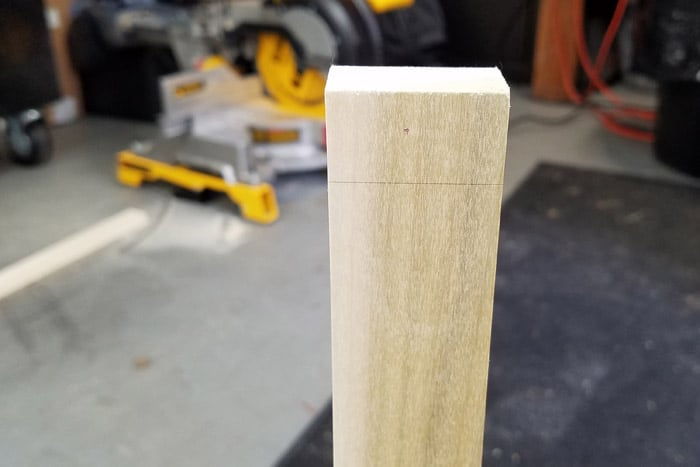 """1x2 board with a pencil line at 3/4"""" from the top."""