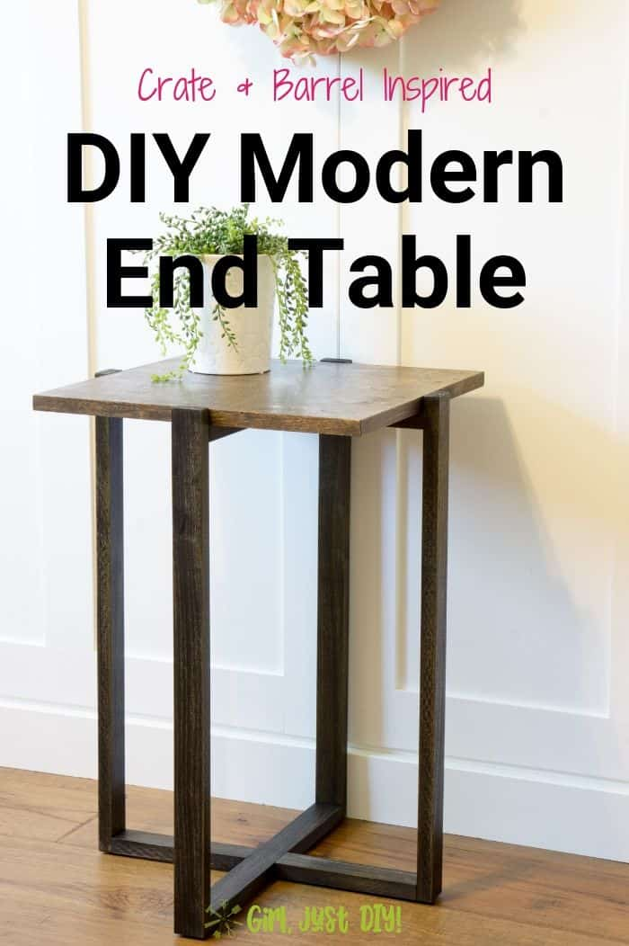 Walnut and Ebony DIY End Table by wall with a houseplant on top below a wreath.