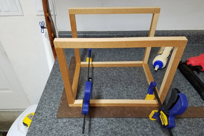 Card box dowel frame held together with clamps.