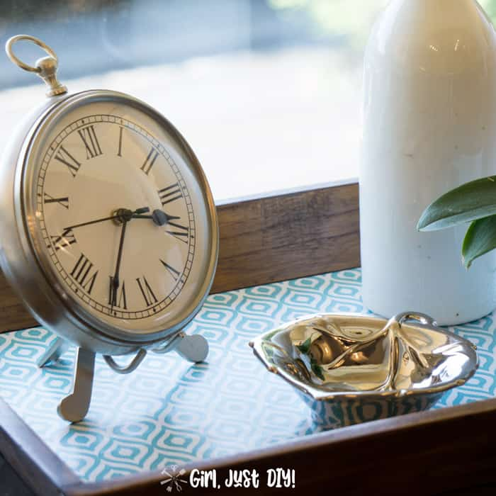 Clock and metal leaf on tray after fast wooden tray update.